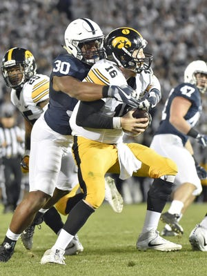 While the offense is getting most of the rave reviews, Penn State's defense has made the most surprising turnaround in the Big Ten. It yielded only 30 rushing yards to sturdy Iowa and tormented QB C.J. Beathard throughout. Here, Kevin Givens sacks him in the second half.