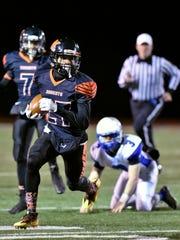 Northeastern's Taemar Willis carries the ball against