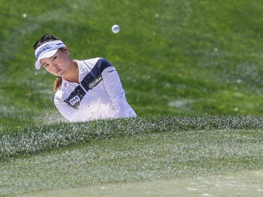 So Yeon Ryu hits out of a greenside bunker on the 17th