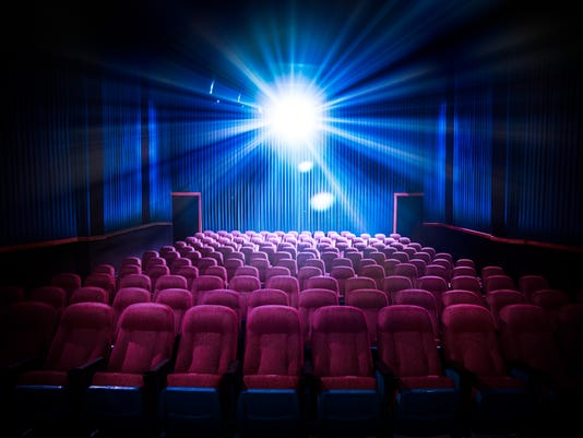 High contrast image of empty movie theater seats