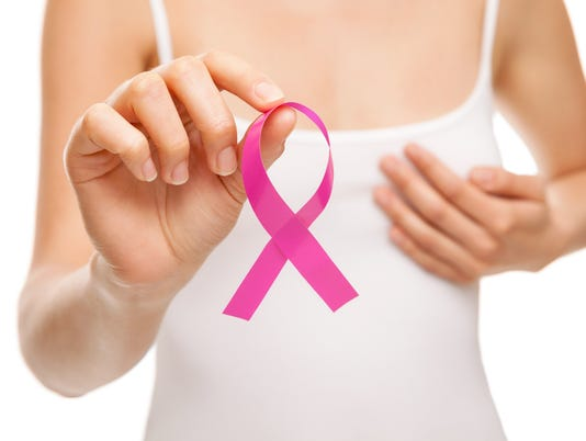 Woman with breast cancer awareness ribbon