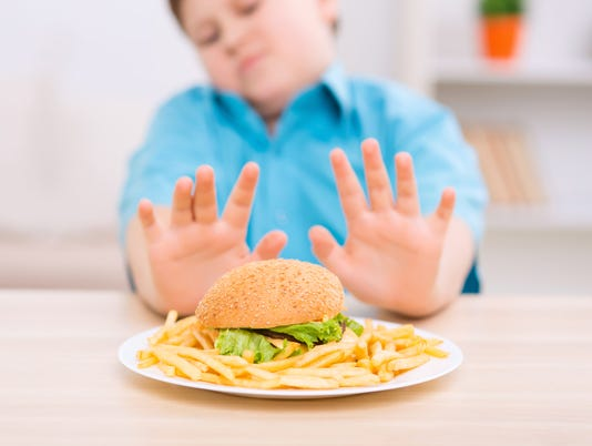 Chubby kid refuses to eat unhealthy food