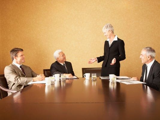 Group of businesspeople at conference table