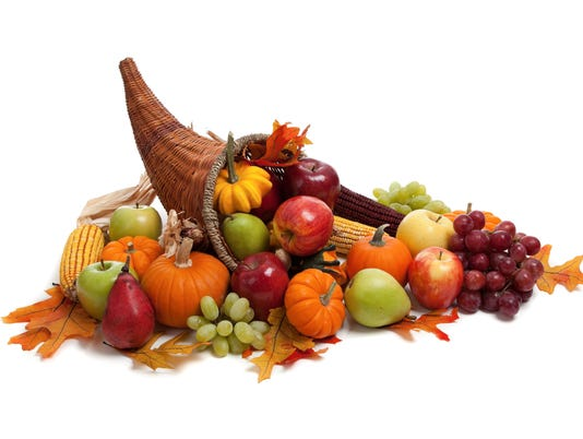 Fall, autumn or harvest cornucopia on a White back ground