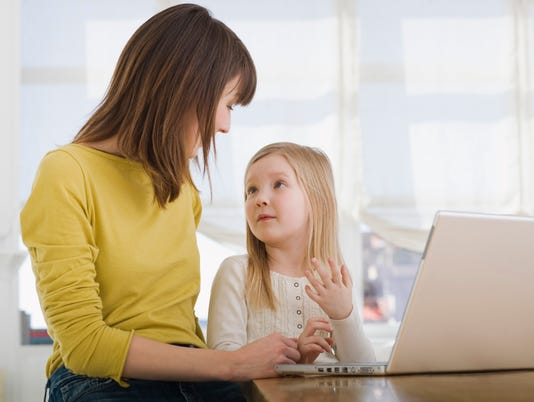 Mother and daughter on laptop computer