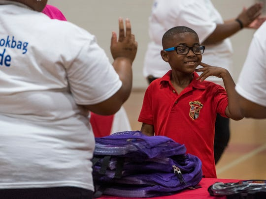 Students receive book bags and school supplies during the first annual Give Back with a Backpack book bag drive at the old Cloverdale gymnasium on the Huntingdon College campus in Montgomery, Ala. on Saturday July 29, 2017.