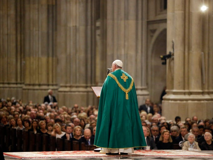 Pope Francis speaks during evening prayer service at