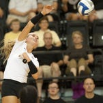 Azariah Stahl goes up for the kill in the first set in a match against Austin Peay.