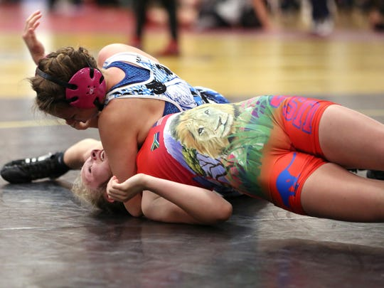 Sweet Home's Marissa Kurtz, top, wrestles Thurston's Macie Stewart in an exhibition round during the girls freestyle/Greco state wrestling tournament on Saturday, April 23, 2016, at Crescent Valley High School in Corvallis, Ore.