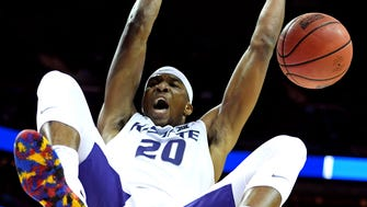 Kansas State Wildcats forward Xavier Sneed (20) dunks the ball against the UMBC Retrievers in the second round of the 2018 NCAA Tournament at Spectrum Center.