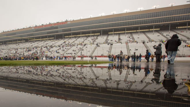 The grandstands at Atlanta Motor Speedway are reflected in a puddle before the NASCAR Sprint Cup Series Folds of Honor QuikTrip 500 on March 1, 2015.