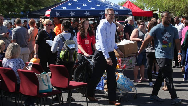 People bring food and supplies for blood donors that were waiting to give blood at the Healthy Living Institute at the University Medical Center after the Las Vegas shooting, October 2, 2017.