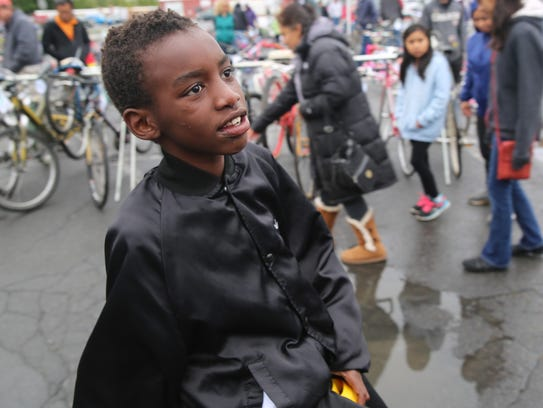 Beatrice Hunter, 8, pleads with her father to let her get a bike on Saturday. She rode on bikes with her two brothers.