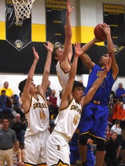 Reed's Tyler Wilson (24) shoots while taking on Galena