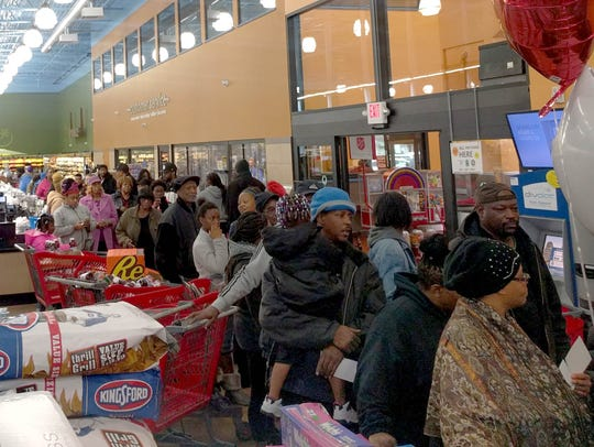 Customers stand in line at Imperial Market on Detroit's
