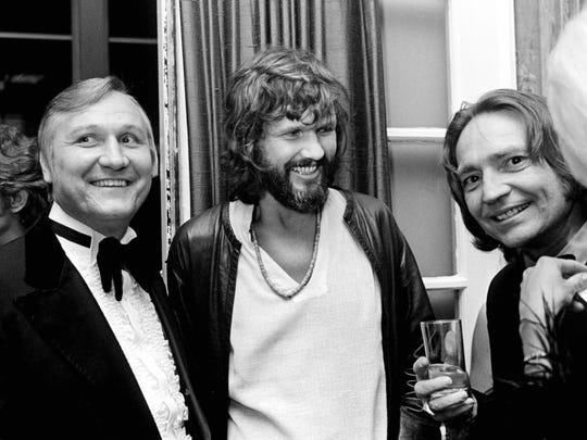 Kris Kristofferson, center, jokes with Metro trustee Glenn Ferguson, left, and Willie Nelson at BMI's annual banquet at Belle Meade Country Club on Oct. 17, 1972.