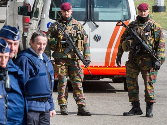 Belgian police men and soldiers secure the area outside Zaventem Airport in Brussels, Tuesday, March 29. Tuesday, airport authorities inspected the construction and fire safety of the temporary constructions and airport staff tested the temporary arrangements and infrastructure for the check-in procedure.