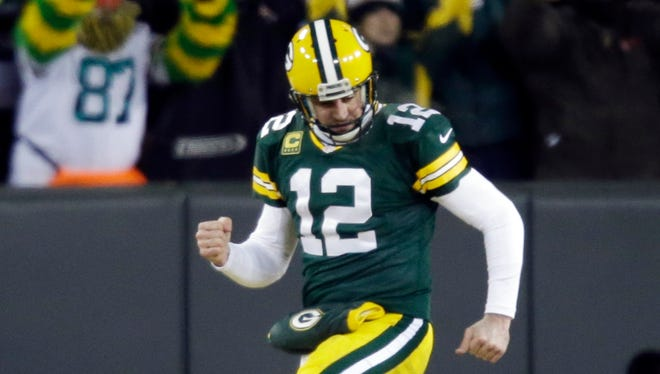 Green Bay Packers quarterback Aaron Rodgers reacts to a touchdown during the second half of an NFL wild-card playoff football game in 2014. (AP Photo/Jeffrey Phelps)