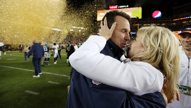 Denver Broncos head coach Gary Kubiak kisses his wife Rhonda Kubiak after beating the Carolina Panthers in Super Bowl 50 at Levi's Stadium in 2016. Kubiak stepped down from his position as head coach Monday.