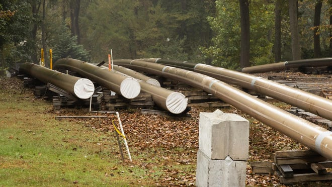 FILE - In this Oct. 22, 2019 file photo, pipes lay along a construction site on the Mariner East pipeline in a residential neighborhood in Exton, Pa. The FBI is investigating how Gov. Tom Wolf's administration came to issue permits for construction on a multibillion-dollar pipeline to carry natural gas liquids across Pennsylvania, The Associated Press has learned. (AP Photo/Matt Rourke, File)