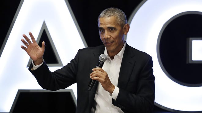 Former president Barack Obama talks as Chris Paul, of the Oklahoma City Thunder, Kevin Love, of the Cleveland Cavaliers, Giannis Antetokounmpo, of the Milwaukee Bucks, and sports analyst Michael Wilbon listen during a conversation on community impact fireside chat in Chicago on Feb. 15.
