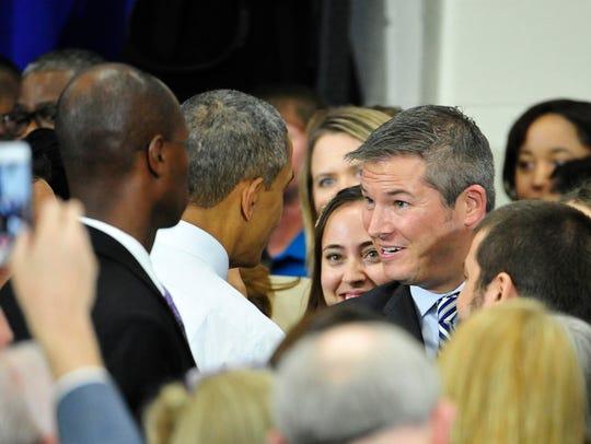 President Barack Obama talks to Jeff Yarbro after speaking