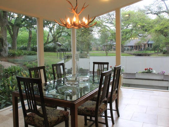 The dining room invites the outdoors in with lush,
