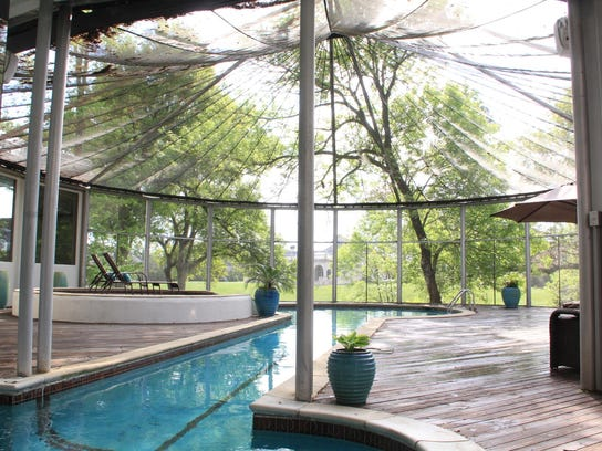 The pool area is completely screened, adding another