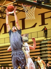 Lakeland's Cass Phillips goes high for the rebound against Milford's Jackson Hale.