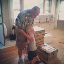 89-year-old Erling Kindem and 3-year-old Emmett Rychner hug before the Rychner family moves away.