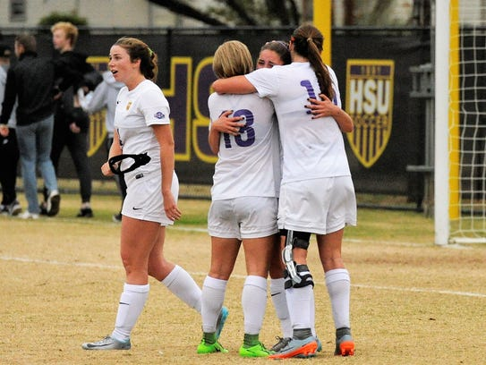 A group of Hardin-Simmons players celebrate following