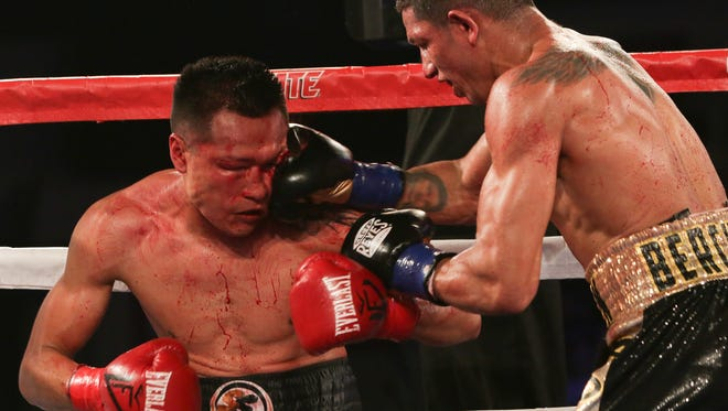 Francisco Vargas (left) takes a punch from Mexican countryman Miguel Berchelt in their world title bout Saturday at Fantasy Springs Resort Casino in Indio.