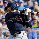 In this Aug. 22, 2015, file photo, Atlanta Braves' Nick Swisher hits a two-run home run against the Chicago Cubs during the fifth inning of a baseball game in Chicago.