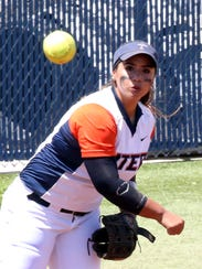 UTEP infielder Kiki Pepi fires to first base against