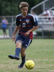 Madison's Joey Soriano dribbles the ball against Jackson