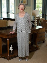 Marjorie Mounts wears a silver mesh-style  formal dress