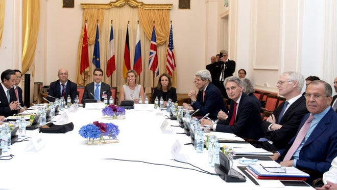 Secretary of State John Kerry, fourth from right, at nuclear weapons negotiations in Vienna on July 7, 2015.
