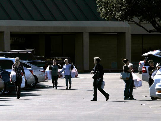 Shoppers leave J.C. Penney's on Black Friday.