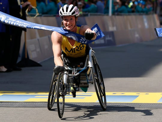 Apr 18, 2016; Boston, MA, USA; Tatyana McFadden of the United States crosses the finish line to win the women's wheel chair division of the 120th Boston Marathon. Mandatory Credit: Greg M. Cooper-USA TODAY Sports