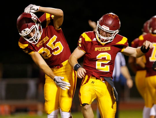 McCutcheon quarterback Peyton Williams, right, celebrates