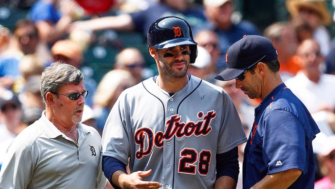 Jul 8, 2015; Detroit Tigers right fielder J.D. Martinez (28) talks with manager Brad Ausmus after being hit in the hand by a pitch during the game against the Seattle Mariners in the seventh inning at Safeco Field.
