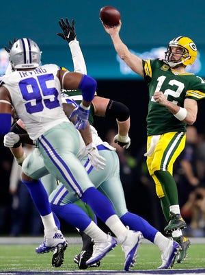 Green Bay Packers quarterback Aaron Rodgers throws in the fourth quarter against the Dallas Cowboys in the NFC divisional playoff game on Sunday, January 15, 2017 at AT&T Stadium in Arlington, Texas.