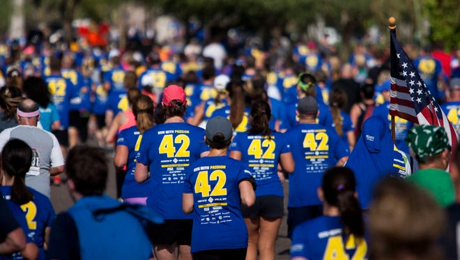 Runners near Sun Devil Stadium at the end of Pat's Run 2015 on Saturday, April 25 in Tempe.