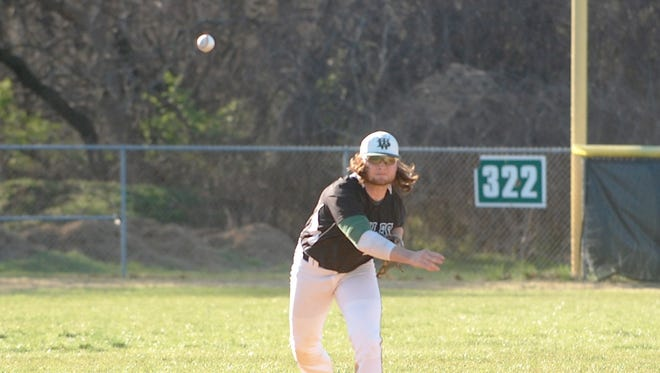 West Deptford shortstop Kyle Garrison fires to first for one of his seven assists in Tuesday's win over Haddonfield.