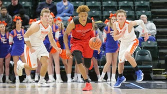 New Albany guard Romeo Langford (1) charges up the court ahead of Silver Creek's Jacob Garrett (42), and Cooper Jacobi (44) during Basketball Day Indiana at Bankers Life Fieldhouse in Indianapolis on Jan. 6, 2018.