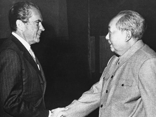 FILE - In this Feb. 5, 1972 file photo, U.S. President Richard Nixon shakes hands with Communist leader Mao Tze-tung during Nixon's historic trip to Communist China. The two countries had no relations whatsoever from 1949, when Mao Zedong's communists took power, to 1979, when Jimmy Carter and Deng Xiaoping established diplomatic ties that have endured through good times and tension ever since. The relationship is usually cordial, but the long game is one of unease: China has long believed the United States is trying to contain it, and Washington views Beijing's economic heft and increasing presence on the world stage as a strategic and economic threat.  (AP Photo/File)