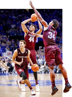 Behind Tyler Davis (34) and Robert Williams (44) are five others on the Texas A&M roster who stand at least 6-foot-9, including fellow starter and 3-point threat DJ Hogg (1).