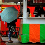A customer waits for their order at the Philly Steak Sandwich booth Monday at the Montana State Fair in Great Falls. A 24-rainfall record of .72 inches broke the previous record of .67 inches set 1909.