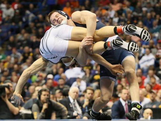 Penn State's Jason Nolf, top, takes down Missouri's