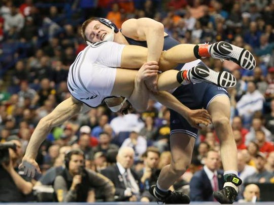 Penn State's Jason Nolf, top, takes down Missouri's Joey Lavallee in their 157-pound championship match during the NCAA Division I Wrestling Championships on Saturday, March 18, 2017, in St. Louis.